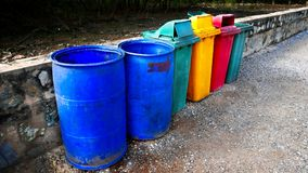 Grungy Old Trash Bins in a Row. Near a Wall Stock Images