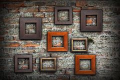 Grungy old wall full of wooden frames Stock Photography