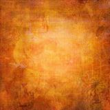 Grungy orange background. With delicate floral design and space for text or image Stock Photos