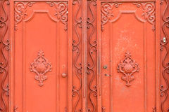 Grungy Orange Colored Iron Gate Stock Image
