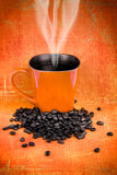 Grungy orange cup of coffee Stock Image