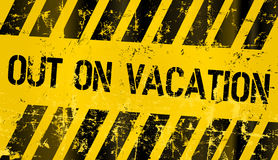 Grungy out for vacation sign Stock Photo