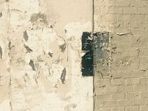 Grungy painted peeling wall industrial brick background Stock Images
