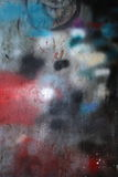 Grungy painted wall. A grungy wall with spray paints Royalty Free Stock Image