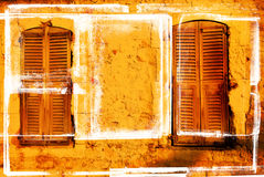 Grungy pair of windows with shutters Royalty Free Stock Image