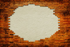 Grungy paper background surrounded by brick frame. Isolated Stock Image