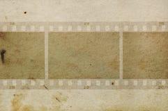 Grungy papper för filmramar Arkivbild