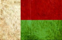 Grungy pappers- flagga av Madagascar stock illustrationer
