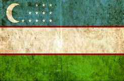 Grungy pappers- flagga av Uzbekistan stock illustrationer