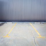 Grungy parking wall Stock Photography