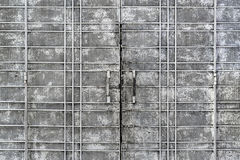 Grungy perforerad metallport Royaltyfria Foton