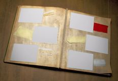 Grungy photo album, free copy space. A dirty photo album with six deckle edged picture frames and copy space - - grunge Royalty Free Stock Photo