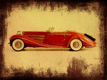 Grungy photo of a car. Faded photograph of old luxury K500 car model with grungy frame Royalty Free Stock Images