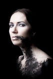 Grungy portrait. Dark grungy portrait of a young girl on a black background with a ragged outline below the shoulder Royalty Free Stock Photo
