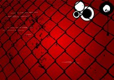 Grungy rött yttersida och staket Arkivfoto