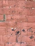 Grungy red brick wall close up with paint splashes royalty free stock image