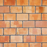 A grungy red brick wall texture, background. Stock Photos