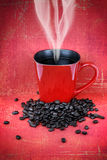 Grungy red cup of coffee Royalty Free Stock Images