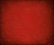 Grungy red gloss painted wall background. Grungy red gloss painted wall with burned frame for Christmas royalty free stock image