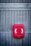 Grungy Red Life Preserver. Red Life Preserver Against Concrete Wall Royalty Free Stock Images