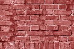 Grungy red toned brick wall texture. Royalty Free Stock Photography