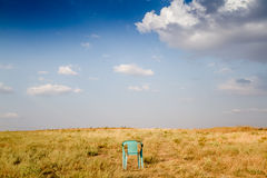 Grungy Retro Damaged Plastic Green Chair Abandoned in a Field Royalty Free Stock Images