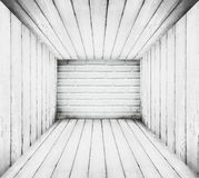 Grungy retro wooden room with one side brick wall background Stock Images