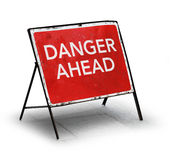 Grungy road sign danger ahead Stock Images
