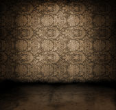 Grungy room. Dark, grungy room with Victorian wallpaper Stock Photography