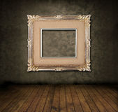 Grungy room. With floral vintage wallpaper, wood floor and antique frame Royalty Free Stock Images