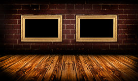 Grungy room with gold frames Royalty Free Stock Images