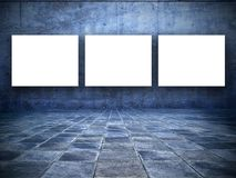 Grungy room with three blank white screens Royalty Free Stock Images