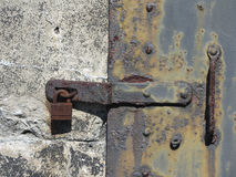 Grungy Rusted Metal Door Lock and Latch Texture Stock Image