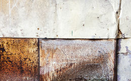Grungy rusted metal wall background texture Stock Photos