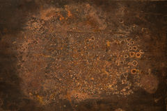 Grungy rusty metal texture. Old rusty metal plate texture heavily aged and corroded. The corrosion stain creates a grungy rust frame Stock Photography