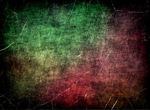 Grungy scratched multicolored texture as abstract background. Stock Photography