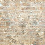 Grungy shabby vintage brick wall with floral pattern. Grungy shabby vintage brick wall with brown floral pattern royalty free stock photography