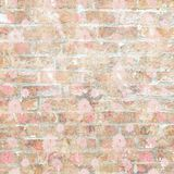 Grungy shabby vintage brick wall with floral pattern stock photos
