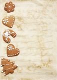 Grungy sheet music paper with Christmas cookies. Stock Image