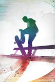 Grungy Skateboarder. Grungy textured skateboarder silhouette with rainbow colored accents Royalty Free Stock Images