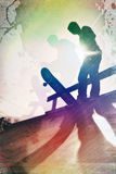 Grungy Skateboarder. Grungy textured skateboarder silhouette with rainbow colored accents Stock Photo