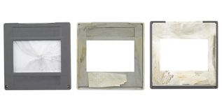 Grungy slides,picture frames,. Battered grungy 35mm slides, grungy and dirty,one cover slip broken, isolated on white background,free sapce for your pics Stock Images
