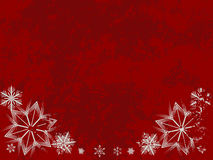 Grungy snowflake border. On a red background with copyspace Stock Photo