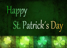 Grungy St. Patrick´s Day Shamrocks. A St. Patrick´s Day illustration: 4 different shamrock shapes and Happy St. Patrick´s Day letters in the irish flag Royalty Free Stock Photo