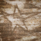 Grungy star on paper texture Royalty Free Stock Photos