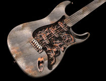 Grungy steam punk guitar Stock Images