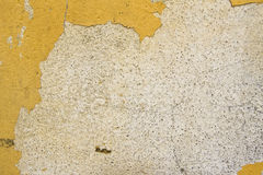 Grungy stone wall. Grungy yellow stone wall artistic background Royalty Free Stock Images