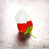 Grungy strawberry. With whipped cream, still life Royalty Free Stock Photo
