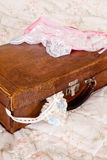 Grungy suitcase and lace lingerie Stock Photo