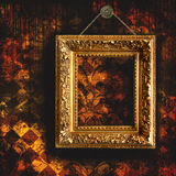 Grungy tattered wallpaper with empty  frame Royalty Free Stock Photos